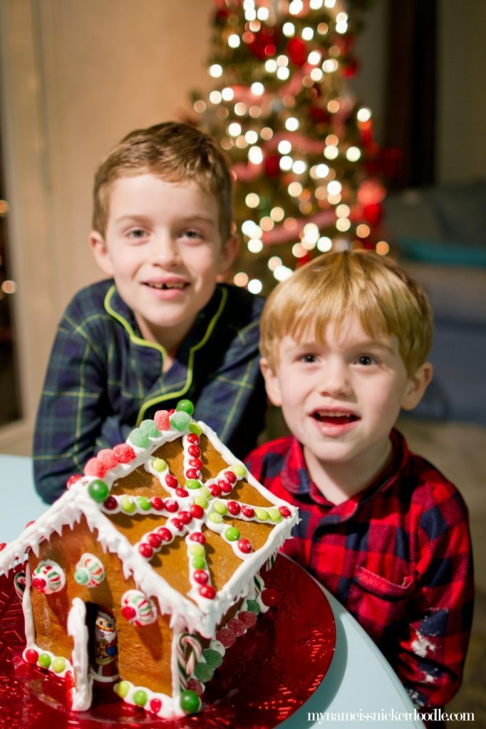 Kids with a gingerbread house for Christmas