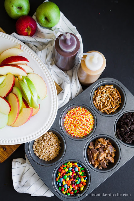 Caramel Apple Nacho Bar with chocolate syrup, toffee, sprinkles, candies and pretzels
