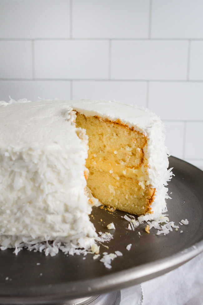 Easy coconut cake recipe using a boxed white cake mix dressed up with some special ingredients