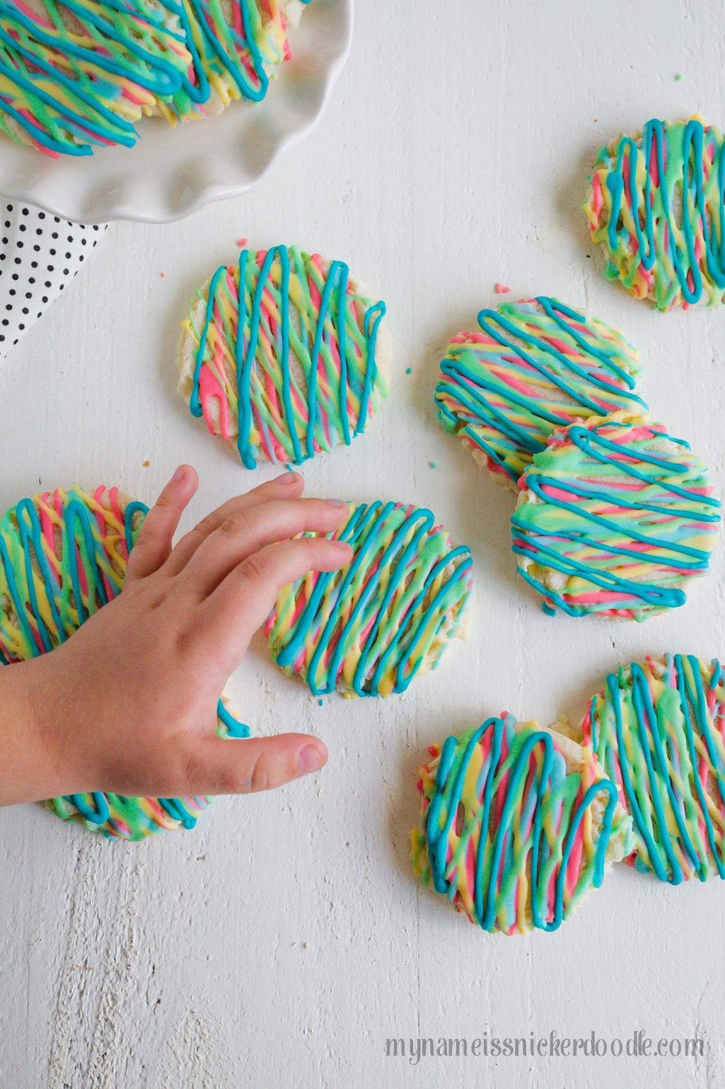 Colorful Sugar Cookies are a fun way to explore color and eat your food too. These delicious sugar cookies are made with an easy recipe that will keep you coming back for more. It will become your new go to sugar cookie recipe. #sugarcookies #cookierecipe #sugarcookierecipe #swigsugarcookierecipe