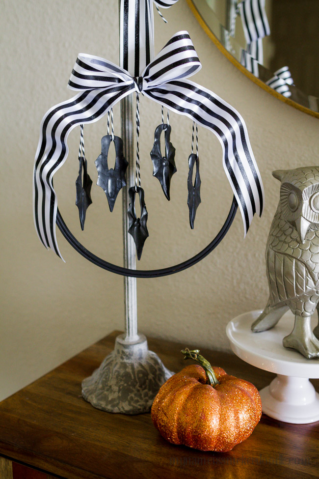 Halloween Hanging Bat Wreath made with an embroidery hoop, cute ribbon and plastic bats