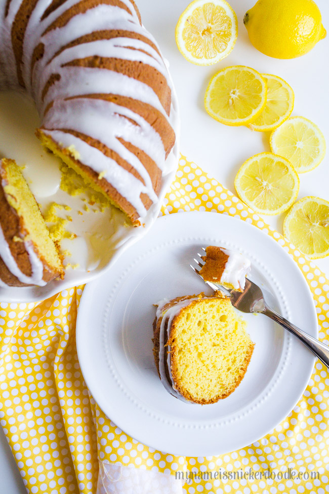 Lemon Bunt Cake On A White Cake Plate