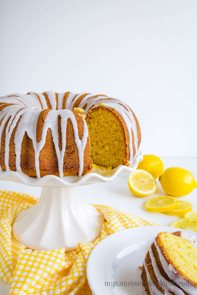 Lemon Bunt Cake Sliced On A White Cake Plate