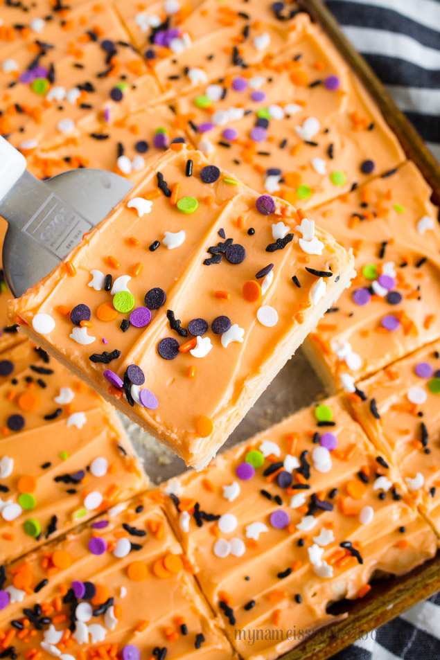 Sugar Cookies with Orange Frosting and Halloween Sprinkles