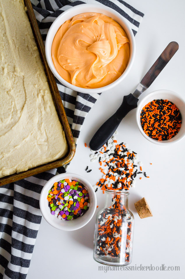 Halloween Sugar Cookie Bars In A Baking Sheet With Sprinkles