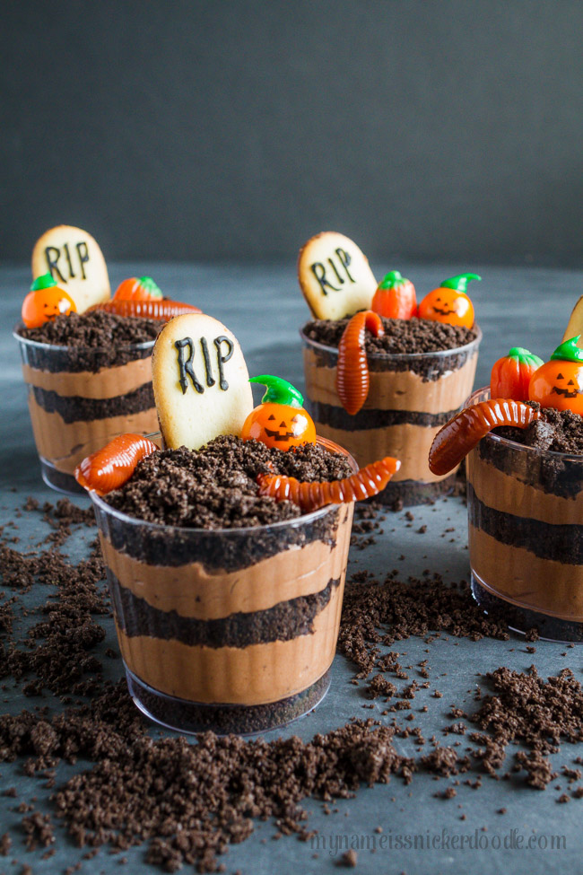 Graveyard Pudding Cookie Cups with gummy worms and candy pumpkins