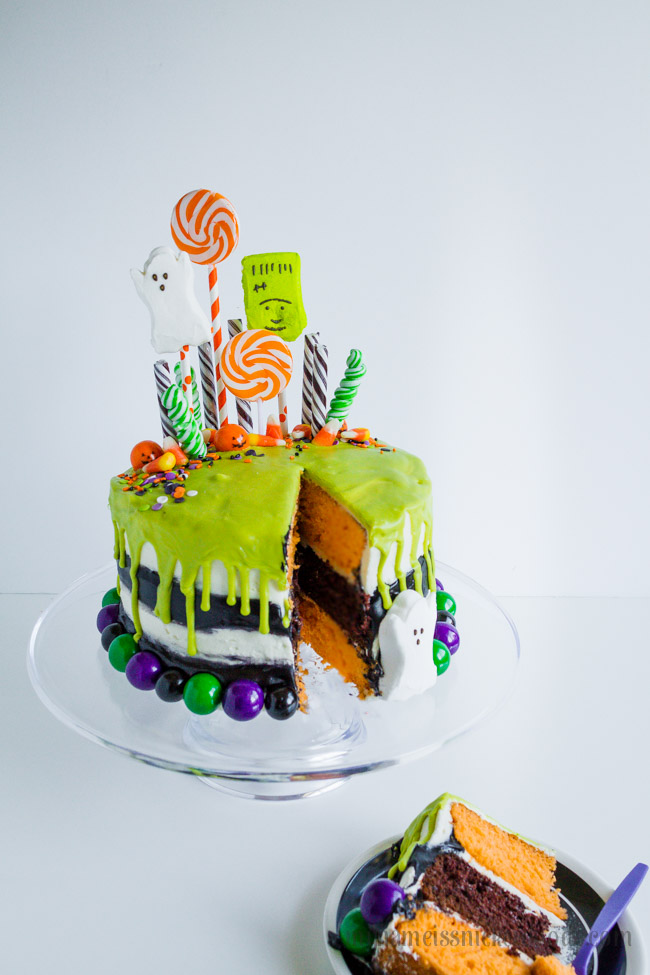 Halloween Layered Vanilla and Chocolate Cake With Candy, Suckers and Gumballs