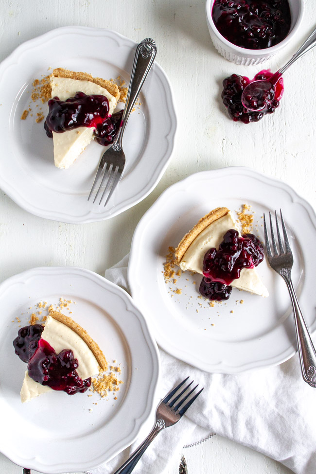 Two slices of no bake cheesecake on a white table.