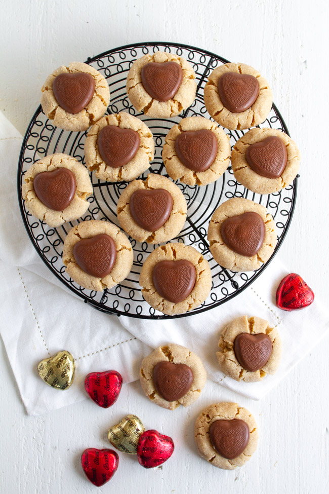 Peanut Butter Blossoms Valentine Version with a chocolate heart on a wire cooling rack