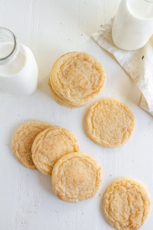 Snickerdoodle cookies on a white table.