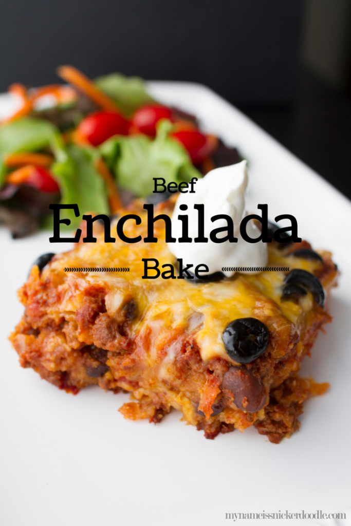 Beef Enchilada Bake on a white plate with a dollop of sour cream.