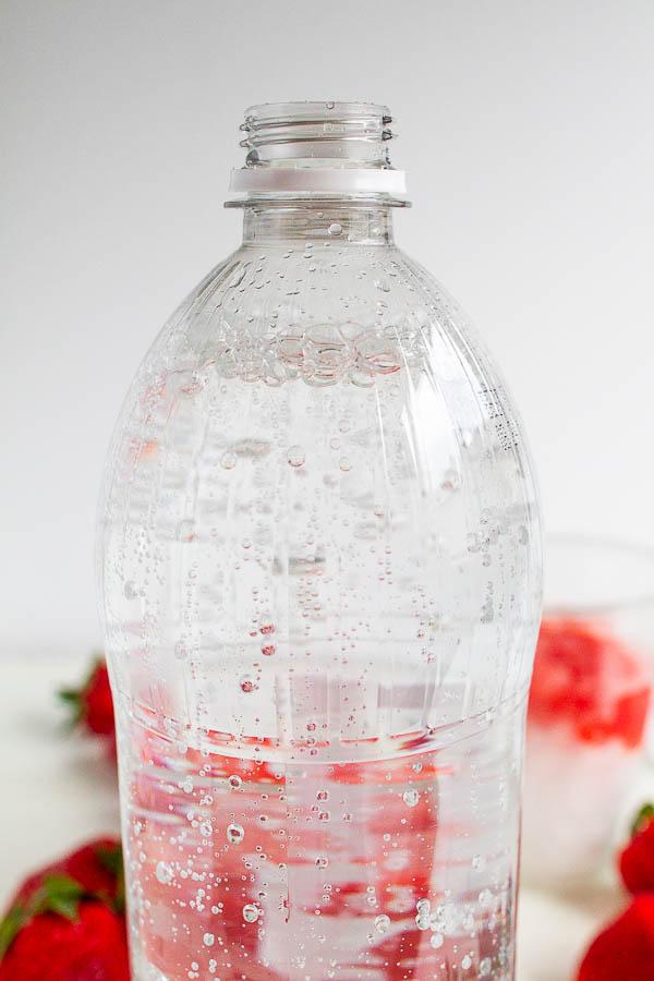 A bottle of club soda.