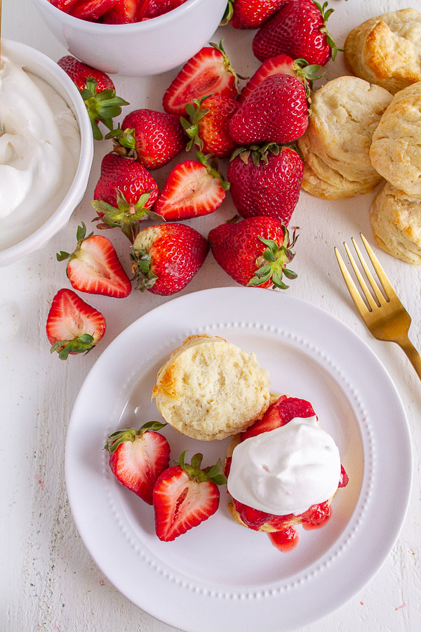 Strawberry Shortcakes topped with fresh strawberries and real whipped cream.