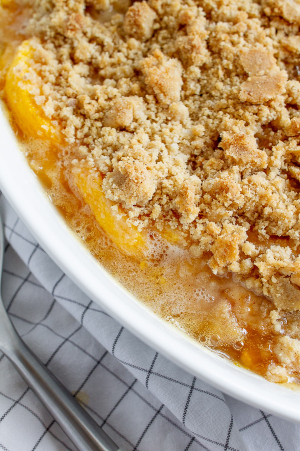 Bubbling sweet peaches topped with a buttery golden brown crumble.