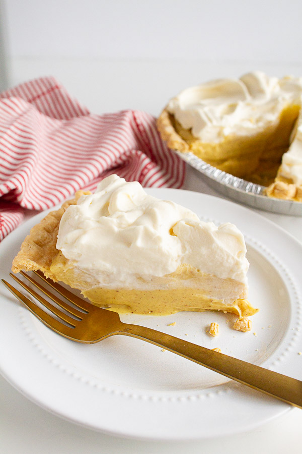 Holiday Eggnog Pie is a super simple recipe with a slice on a white plate.