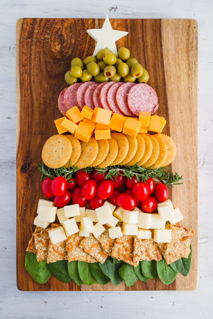 The Ultimate Holiday Appetizer!  A Christmas Tree Cheese and Cracker Tray would be great for any holiday party.  Full of meats, cheeses, crackers and vegetables.  The easiest charcuterie board to assemble!  #charcuterie #holidayappetizer #mynameissnickerdoodle #cheeseandcrackers #partyfood #christmasappetizers #easyappetizers #appetizerrecipes #christmasrecipes