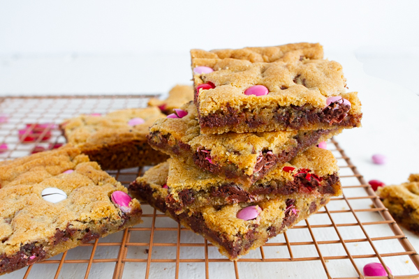 Valentine Chocolate Chip Cookie Bars with pink and red candies.