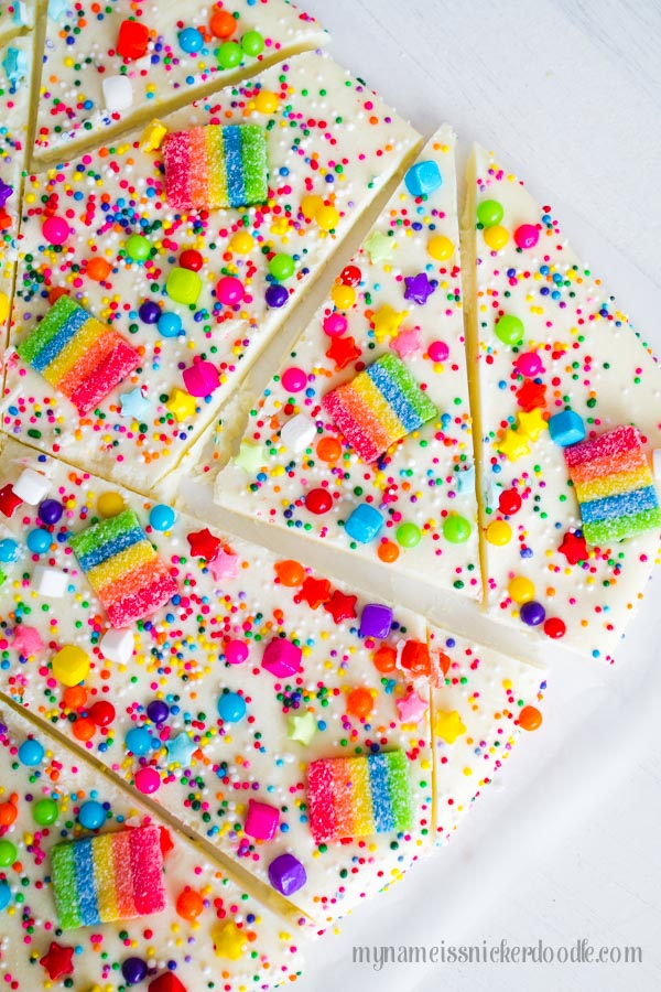 Melted white chocolate with rainbow sprinkles on top.