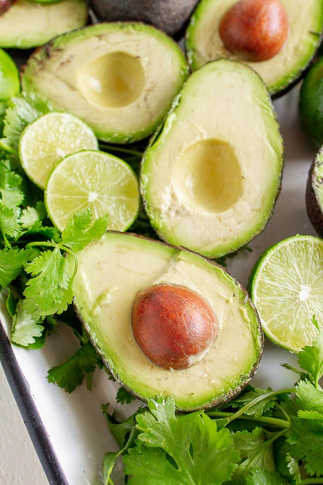 Fresh avocados and cilantro.