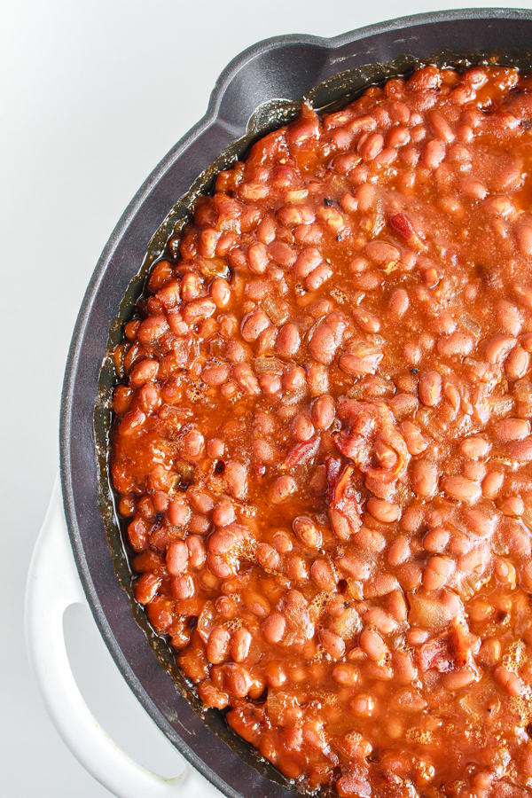 Easy side dish of beans in a black cast iron skillet.