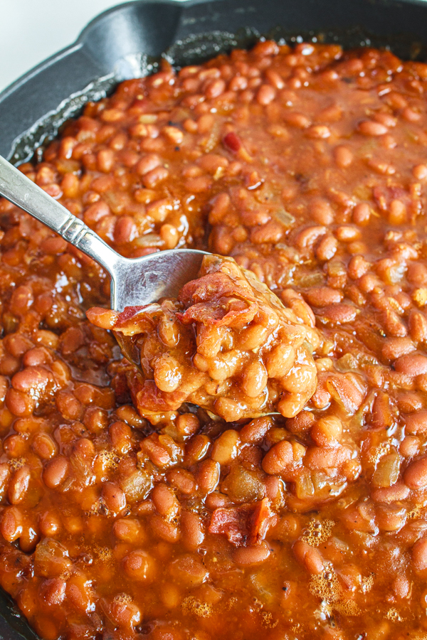 A spoonful of the easiest baked beans recipe.