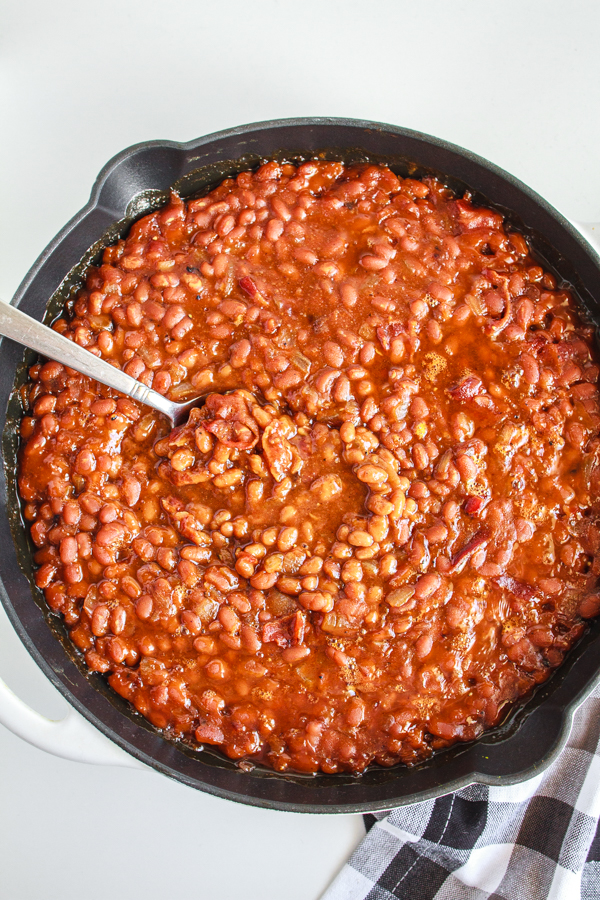 Easy Baked Beans in a black cast iron skillet.