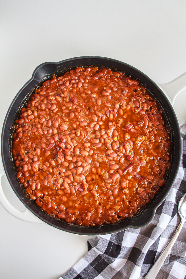 BBQ beans in a black skillet.