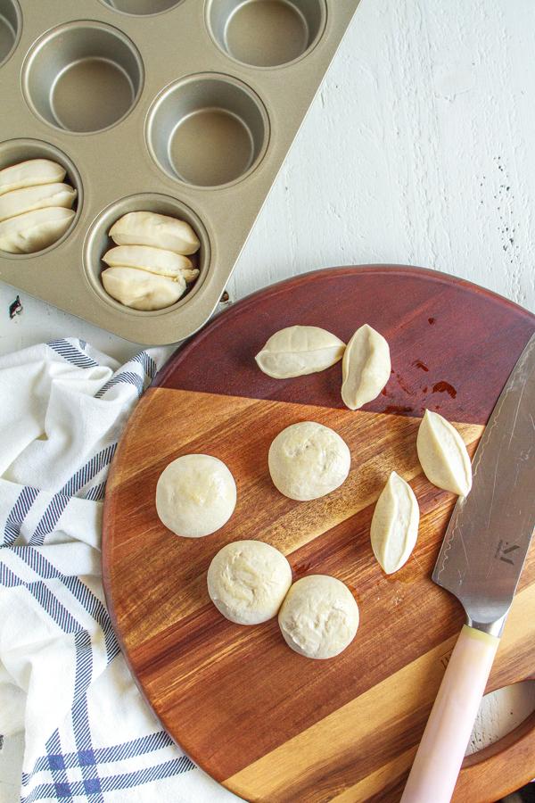 Bread dough cut in half.
