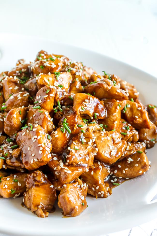 Sesame Chicken sprinkled with sesame seeds and chopped chives.