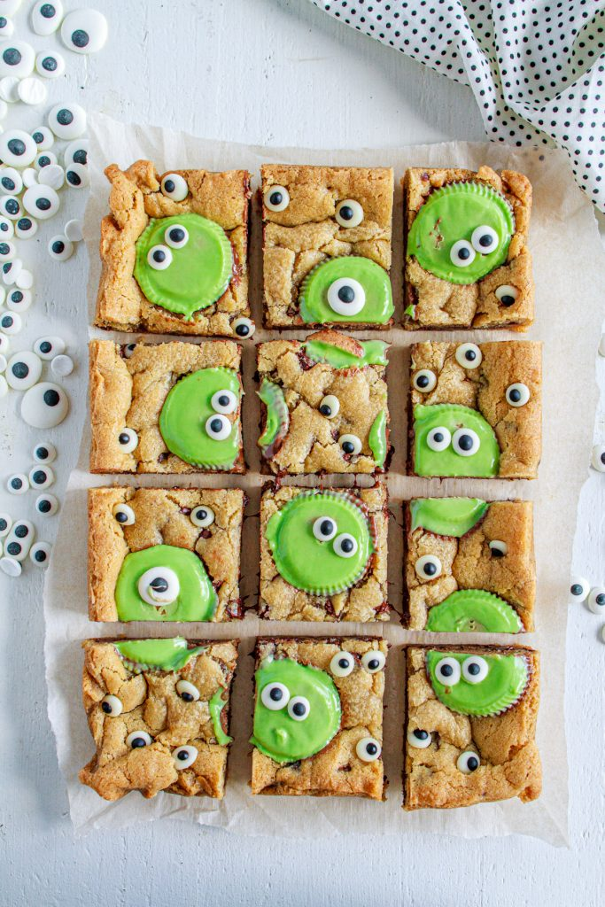 Monster Peanut Butter Cookie Bars cut into squares.