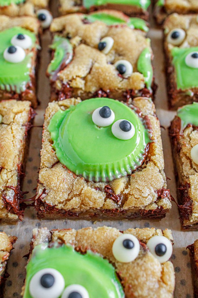 Spooky chocolate chip cookie bars with googley eyes and green peanut butter cups.