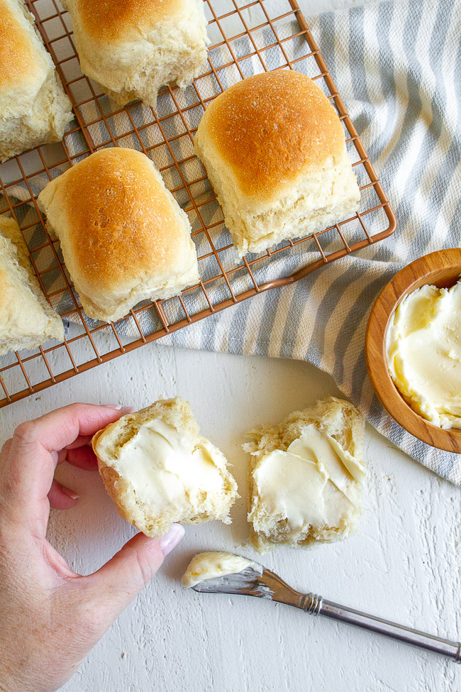 Easy homemade rolls spread with butter.