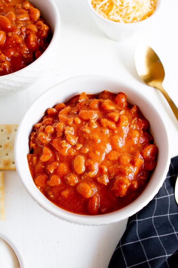 A white bowl full of chili.