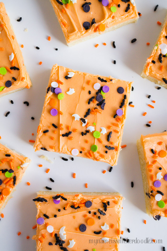Halloween Sugar Cookie Bars can be made in 30 minutes from start to finish. The entire recipe makes 30 cookies and is perfect for a party, potluck or get together! The dough is tender and soft and the buttercream frosting is super creamy and smooth. Use any festive sprinkles you have and don't be afraid to mix to varieties together.