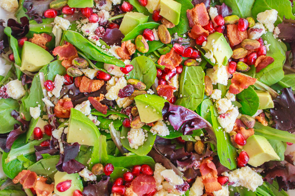 Holiday recipe for Pomegranate Avocado Salad with bacon, pistachios and wensleydale cheese.
