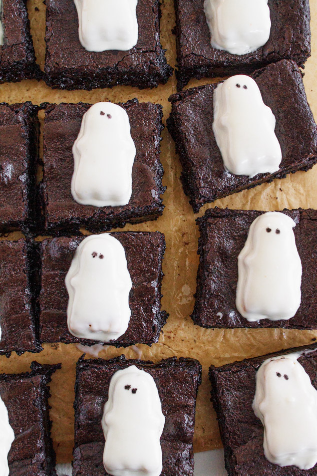 Ghost Brownies are the Halloween Dessert that is a must make this season!  The entire recipe is made in one bowl.  Mostly made with simple pantry ingredients like butter, chocolate chips and eggs.  It also includes black cocoa powder.  This coco powder adds the dark color you need to achieve the blackness that make these a little extra spooky!